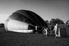 Balloon Inflation Process:  Fan Included (brev99) Tags: tulsa tulsaballoonfestival d610 hotairballoons balloonists crew snapheal macphun perfecteffects17 ononesoftware on1photoraw2017 dxofilmpack5 nikviveza nikdfine blackandwhite bas ket tamron28300xrdiif