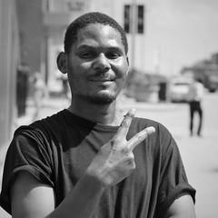 Hilton (michael.veltman) Tags: peace project man sign portrait