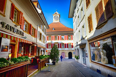 City Hall in Murten, Switzerland (` Toshio ') Tags: toshio switzerland murten morat medieval city town history cityhall hoteldeville restaurant cafe store street architecture europe european fujixe2 xe2 clock cello bass tavern