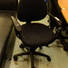 Black fabric swivel chair comes with arms E55