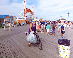 Boardwalk can man on bike with cheeseburger bike bell (TheeErin) Tags: unitedstates boardwalk brooklyn coney island people crowd cans recycling summer 2017 directstare sunglasses beach street streetshot streetphoto being there beingthere summertime thunderbolt metalscrapper scrapper