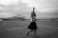 Dancing with a Balloon (filippos.pantazis) Tags: nafplio greece port child dance blackwhite bw blur vignette balloon dusk cloudy