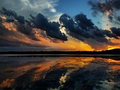 IMG_20170709_222538_809 (krissos.photography) Tags: photographybykrisso monthjuly year2017 seasonsummer naturephotography lightandshadow lakeharriet minneapolisminnesota cloudscapes clouds horizon sunset sunlight dusk between reflection lake water beautiful