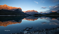 Upper Lake panorama (Canon Queen Rocks (1,610,000 + views)) Tags: upperlake landscape lake landscapes sky scenery scenic reflections water clouds reds dawn sunrise rocks kananaskis alberta canada rockies panorama landschaft momentsbycelinecom nature blue light calm