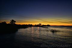 Smokey Sunset 3 (BluAlien) Tags: nikon d800 1424mm 28 sky sunset clouds smoke smokey wildfire grassfire water lake river delta