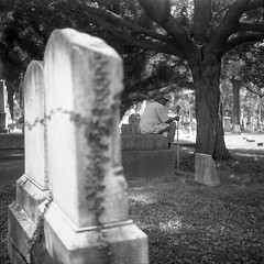 (patrickjoust) Tags: tlr twin lens reflex 120 6x6 medium format black white bw home develop discontinued expired film blancetnoir blancoynegro schwarzundweiss manual focus analog mechanical patrick joust patrickjoust baltimore maryland md usa us united states north america estados unidos urban street city grave tomb tombstone ivy tree greenmount man sitting caretaker