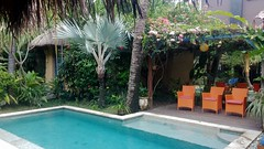 Private Seminyak villa garden, Bali (scinta1) Tags: indonesia bali seminyak villa garden pool green peaceful tranquil restful tropical trees palms leaves flowers bohemian private plants water relaxing orange chairs mirror shadows shade