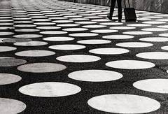 Berlin Holes (NeilDonaldson) Tags: somethingdifferent bnw 1232mm mirroless urban berlin black white architecture artistic holes lumix pancake lens g80 fun people