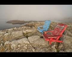 ease into the day (Gordon Hunter) Tags: adirondack chairs red blue fog mist morning rock stone shore ocean oceanside calm quiet relax recline sit rest chip peal paint weathered beach mcneill bay victoria bc canada gordon hunter nikon d5000