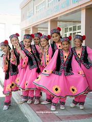 Girls in Traditional Outfits Posing For a Photo in Moynaq, Uzbekistan, 2017 (deemixx) Tags: karakalpakstan uzbekistan moynaq traditionalcostume traditionaldress traditionalgarb