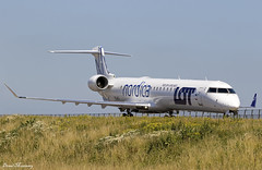 Nordica (LOT) CRJ-900 ES-ACI (birrlad) Tags: amsterdam ams schiphol international airport netherlands aviation aircraft airplane airplanes airline airliner airways airlines nordica lot crj canadair bombardier crj900 esaci taxi taxiway arrival arriving landed runway