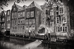Old City Lightplay (Alfred Grupstra) Tags: canal architecture blackandwhite house old buildingexterior history builtstructure urbanscene river oldfashioned netherlands cultures outdoors water famousplace city europe dordrecht