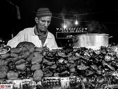 Dinner at 22 in Marrakech (Alesfra) Tags: mzuiko17mmf18 alesfra alesfrafotografia alesfraphotography alesfracom em1 foto jemaaelefna marrakech marruecos medina mirrorless morocco olympus olympusem1 olympusomdem1 omd photo sinespejo wwwalesfracom zoco albertojespiñeirafrancés portrait retrato man food comida cena lunch work cook cooking cocinero anciano viejo cara face rostro gorro caldero fogón bulb bombilla luz light humo smoke bottle botella agua water africa hombre oldman old mzuiko 17mm worker working chef street streetphotography gente monocromático night noche people blackandwhite