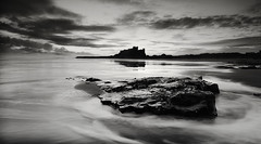 Rock and Castle (Elidor.) Tags: bamburgh castle mono bw northumberland northeast elidor d90 fortress silhouette