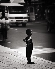 the boss (62dingos) Tags: street candid kid child city urban standing road monochrome travel cambodia phnompenh asia 100 100favs inexplore