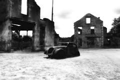 Oradour-sur-Glane France 2017 (Delay Tactics) Tags: france massacre 10061944 10 june 1944 oradoursurglane black white bw infrared street ruins clouds sky 06 deserted empty grass old car dr doctor jacques desourteaux peugeot