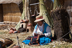 Uros Island Worker (kate willmer) Tags: reeds houses island hat costume pots craft uros titicaca peru people woman