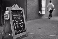 Are you leading me to the food? (Tracey Rennie - away) Tags: flickrcation monochrome bokeh gastown vancouver blackandwhite restaurant chalkboard sign nomnomnom