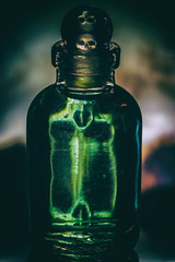 The Difference Between Medicine and Poison is in the dose......(Circa Survive) (Boba Fett3) Tags: macromondays poison poisonous skull refractions dof depthoffield bottle liquid green danger dangerous toxic canon1dmkiv canon100mmf28 closeup upclose warning