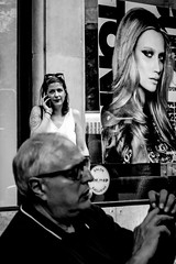 Four faces, one hidden (aclapes) Tags: nuria lapatzem diagonal faces man men woman women blackandwhite bnw streetphotography terrace reflexes phone advertising streetphoto canon 700d dslr canonistas barcelona
