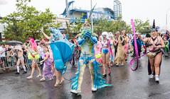 Mermaid Parade Wedding - 3 (UrbanphotoZ) Tags: mermaidparade coneyislandmermaidparade marchers costumes newlyweds justmarried chuck bambi chuckandbambi spectators coneyisland brooklyn newyorkcity newyork nyc ny man woman entourage crowns fins tangled beard hair scales pinkhair tutu bodypaint