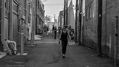 Alley BW:  Style #3 (brev99) Tags: d610 tamron35f18vc blackandwhite alley bradyartsdistrict tulsa bullinthealley buildings people viewnx2 cacorrection pedestrian widecrop perfecteffects17 on1photoraw2017 ononesoftware nikoutputsharpener