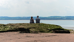 watching wales (paul hitchmough new) Tags: paulhitchmoughphotography riverdee river northwales westkirby candid streetphotography sun relaxing nikond800 nikonphotograhy nikon nikon2470mm rocks sand landscape