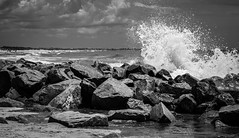 A wave crashes along the NC/SC boundary (T.M.Peto) Tags: wave waves crashingwave wavecrashing spray mist oceanspray seaspray sea ocean oceanwave beach inlet rocks boulders coast coastline jetty jettyrocks blackandwhite blackwhite blackandwhitephotography outdoor outdoors getoutside northcarolina southcarolina water saltwater nikond3300 nikon nikonphotography nikonoutdoors lightroom adobelightroom travel travelphotography crashing lightandshadow clouds landscape landscapephotography landscapes geography birdisland scenicsnotjustlandscapes shore shoreline littleriverinlet
