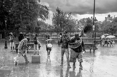 And the Band Played On (Billy Woolfolk) Tags: ricoh ricohgr mirrorless neworleans frenchquarter jacksonsquare rain storm jazz busker streetphotography street musician band brassband apsc louisiana リコー リコーgr ミラーレス ニューオーリンズ ジャクソン・スクエアー ジャクソン広場 フレンチ・クオーター ルイジアナ州 ストリートフォトグラフィー