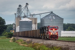 Ex Indiana Railroad in Monnett, Ohio (Brandon Townley) Tags: trains railroad ns indianarailroad sd90mac grainelevator clouds cloudy coal coaltrain red soybeans 7337 ohio