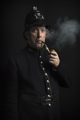 the smoking policeman (james_drury) Tags: portrait cast theatre policeman smoking actor pipe strobe flash octabox softbox 80cm lastolite canonef2470mmf28liiusm