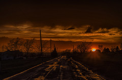 It Can All Change in a Minute (Paul B0udreau) Tags: nikkor50mm18 photoshop canada ontario paulboudreauphotography niagara d5100 nikon nikond5100 raw sunset sunrays silhouette road country rural lincoln wet aftertherain clouds