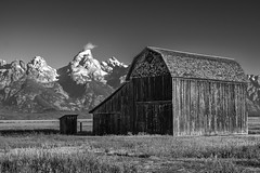 A Barn on Mormon Row (T.M.Peto) Tags: grandtetonnationalpark jacksonhole wyoming grandteton tetonrange tetons wy barn barns mormonrow farm farmland oldbuilding historic historicsite nationalpark nps nps100 blackandwhite blackwhite blackandwhitephotography landscape landscapephotography landscapes landscapeshots scenicsnotjustlandscapes scenic scenery scenics travel travelphotography mountain mountains mountainside mountainpeak mountainpeaks mountainridge mountainrange nikond3300 nikon nikonphotography nikonoutdoors outdoor outdoors outdoorphotography grass grassland valley field snow monochrome glaciers cloud lightroom adobelightroom