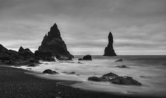 Once upon a time on a far away planet (PeterThoeny) Tags: vik iceland blacksandbeach reynisdrangar night basaltrock rock sony sonya7 a7 a7ii a7mii alpha7mii ilce7m2 fe2870mmf3556oss longexposure 1xp raw monochrome blackandwhite photomatix hdr qualityhdr qualityhdrphotography fav200 coast beach fullframe