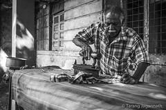 iron clothes (Tarang Jagannath : http://www.TarangJagannath.com) Tags: old man iron clothes press roadside realpeople blackandwhite india