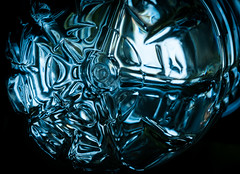 Beautiful Design in a Common Water Bottle (really_late_bloomer) Tags: macro waterbottle light plastic bottom recycle patterns abstract commonplace seethrough