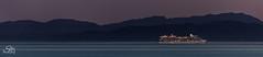 Celebrity Solstice Heading Out to Ketchikan (Selkii's Photos) Tags: britishcolumbia canada celebritysolsticecruiseship cruiseships dusk evening mountain olympicmountains strait straitofjuandefuca sunset vancouverisland water