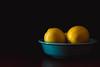 Yellow & Blue (runrgrl661) Tags: lemons fruit citrus bowl fiestaware yellow blue shadows darkbackground tabletop foodphotography nikond5 fullframe