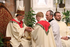 Fr. Kyle Seyler receives the oblations.