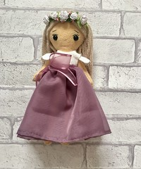 A flower doll ready for a wedding in August