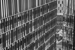 Shuttered (marktmcn) Tags: window shutters shuttered screens screened building floors storeys opening glimpse through facade facia buidlings urban city high rise highrise detail monochrome blackandwhite d610 nikkor 28300mm