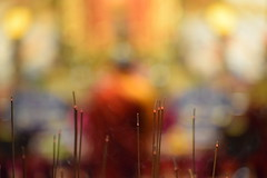 Real and Surreal ! (Sriini) Tags: buddha monk joss sticks incense incensesticks singapore smoke fragrance bokeh color orange saffron relaxation light temple prayers beyondbokeh surreal realsurreal