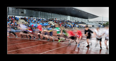 Get set, Go! (tkimages2011) Tags: race start blur motion boys children wet stadium arena sports robinpark wigan sthelens competition color rain reflection puddle track