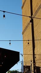 Alley Bar (Mamluke) Tags: darkhorse alley bar patio lights lighting stringlights steeple wall brick sunset stpaulminnesota stpaul mamluke minnesota horse