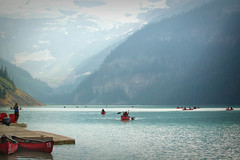 """The mountains are calling, and I must go."" - John Muir (hey ~ it's me lea) Tags: lakelouise mountains banffnationalpark canada150 canada alberta bnp canoes hazy landscape"
