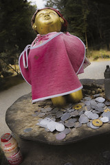 Hoping for more (DanÅke Carlsson) Tags: japan japanese jizo child statue coins money symbol traditional asking gifts offerings