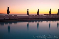 winter sunset 20179 (WITHIN the FRAME Photography(5 Million views tha) Tags: pool westcoast clubmykonos umbrellas silhouettes sunset coastal longexposure southafrica travels fuji fujinon fujilove reflections ndfilter