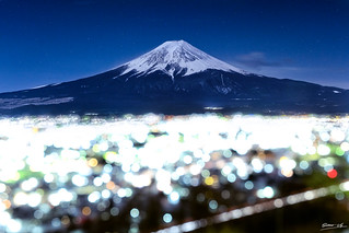 Mt. Fuji with Bokeh at night in Fujiyoshida, Japan