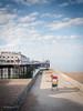 Morning Walk (amipal) Tags: 175mm beach brighton clouds england gb greatbritain manuallens palacepier pier sea seafront sky sussex uk unitedkingdom voigtlander water