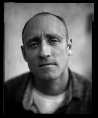 Portrait of a man (Zeb Andrews) Tags: linhoftechnikaiv atomicx new55 4x5 largeformat bw bluemooncamera portrait man person film atwork customer scannedatbluemooncamera epsonv700